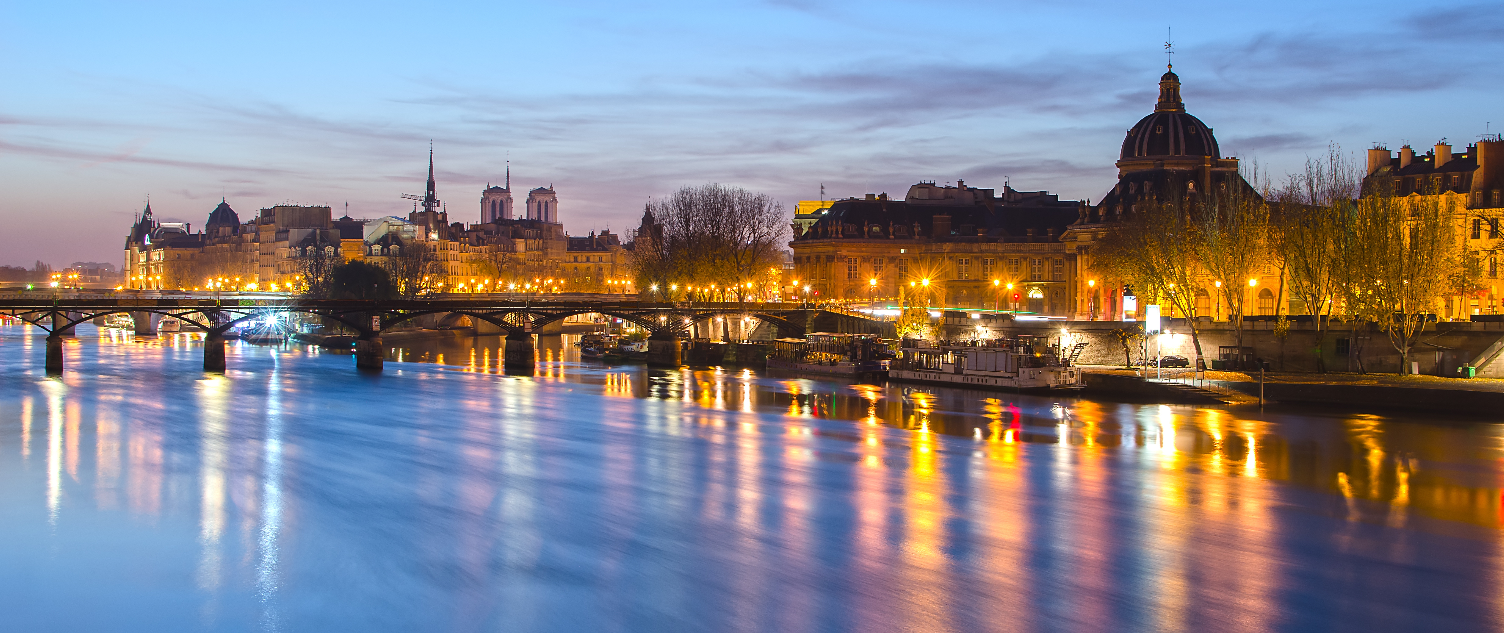 Seine river and Old Town of Paris (France) at night